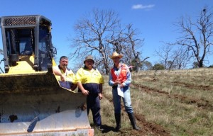 Mark and Peter Rodwell, ripping contractors from Bombala with Lauren Van Dyke, Dieback Project Manager with new deep rip lines in foreground with backdrop of dead trees. Photo: Lachlan Ingram